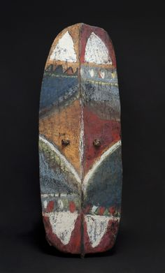 New Guinea  War Shield, Mendi Valley, Southern Highlands, Early 20th C.  Wood, fiber, pigment  46.5 x 17 x .75 inches  118.1 x 43.2 x 1.9 cm