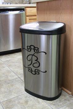 Kitchen waste basket with monogram.