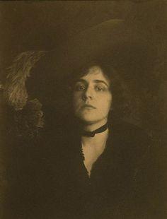 Ethel Reed in plumed hat, c. 1895