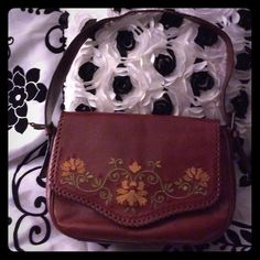Leather hand made in Italy hand bag. 70's vintage Beautiful hand made bag from Italy. genuine leather with embroidery and whip stitch detail. Hobo design with split pockets inside. Rich quality burgundy leather.has an amazing 70's vibe. Capaccioli Bags