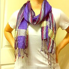 "Multicolor scarf This scarf has never been warn. I have yet to wear it out because we haven't had much cold weather. Base color is purple with some multicolor stripes and ""glittery stripes"". Would be very cute with any color top. Accessories Scarves & Wraps"