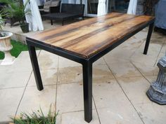 TABLE WITH STEEL FRAME AND RECLAIMED WOOD TOP