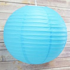 Create a magical atmosphere with affordable Turquoise Round Even-Ribbing Paper Lanterns from the Paper Lantern Store.