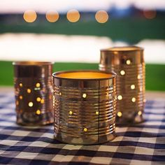 Dress up your BBQ with these cute tin lanterns! Create small holes in different size cans for an outdoor ambiance ✨