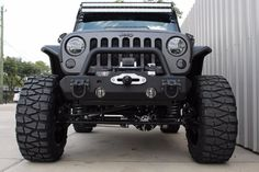 2015 GRAY & BLACK KEVLAR COATED JEEP WRANGLER UNLIMITED SPORT WITH 5.25″ LIFT AND 37″ TIRES – $74,995 | American Wheel and Tire
