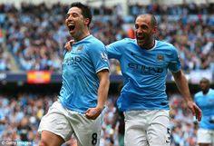 Blue is the colour: Samir Nasri celebrates with Pablo Zabaleta as Manchester City win the title #PremierLeague2013/14.