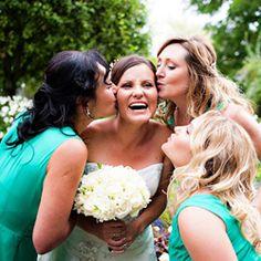awh bridesmaids kissing the bride <3