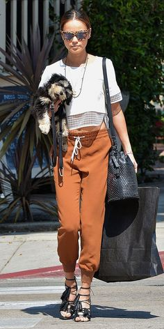 Jamie Chung in a crop top, jogger pants, and sandals