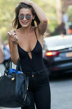 There are 2 tips to buy this bag: bella hadid celebrity style celebrity  model jeans black jeans bodysuit black bodysuit sunglasses black top black  leotard ...