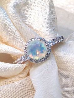 White Opal Ring or Engagement Ring Solitaire in Halo of White Topaz in Sterling Silver and White Gold