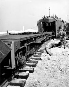 Cherbourg, July 31, 1944: the first LST Train Ferry (LSD-21) arrives and unloads the first train.