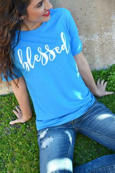 "Our Blessed Tee is a LaRue Exclusive and features a super soft heather turquoise tee with ""Blessed"" printed on the front in white. Model is a size 2 and is wearin Monogram Shirts, Vinyl Shirts, Personalized T Shirts, Tee Shirts, Monogram Shop, Christian Clothing, Christian Shirts, Sweat Shirt, T Shirt Vintage"