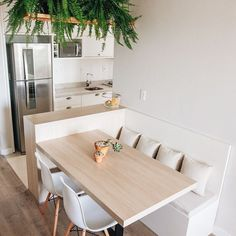 Built in seating is a great way to fit more people round a dinner table if you have a small space
