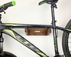 Handmade Plywood Bicycle rack/wall mounted hook for bike | Etsy Bike Hanger, Bicycle Rack, Bike Shelf, Wall Mount Bike Rack, Bike Storage Solutions, Range Velo, Used Bikes, Wood Bike, Clear Plastic Bags
