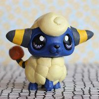 Lps custom Mareep. I honesty have NO idea what lps is behind all that clay and paint....