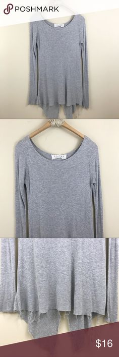 """UO Hiatus Ribbed Asymmetrical Knotted Long Sleeve UO Hiatus Ribbed Asymmetrical Knotted Long Sleeve Top. Back is open and knotted. Super distressed hems/edges. Asymmetrical hem. Grey. Size small. Bust: 34"""" Length: 29"""" Urban Outfitters Tops Tees - Long Sleeve"""
