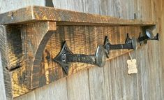 Rustic coat rack made from pallet wood and railroad spikes.