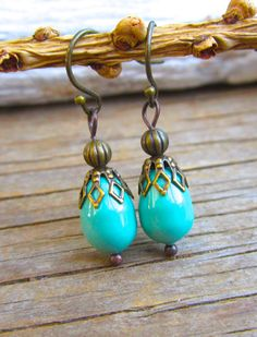 Hey, I found this really awesome Etsy listing at http://www.etsy.com/listing/170842472/turquoise-swarovski-pear-drop-earrings
