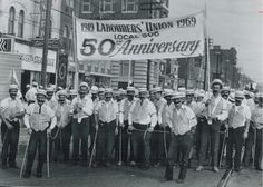 The caption on this Sept. 4, 1976 photo reads: Toronto laborers, celebrating…