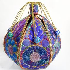 This is a handmade machine stitched textile pod Made from layers of fabric including silk and hand dyed Egyptian cotton It is approximately high or with a circumference of or It has 7 gold loops and on the end of each lo. Textile Fiber Art, Textile Artists, Fabric Art, Fabric Crafts, Creative Textiles, Fabric Boxes, Boho Bags, Free Machine Embroidery, Fabric Manipulation
