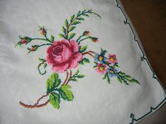 Measures 63 x 47. Made of very soft cotton material. The embroidery is flawless and the colors are vibrant. Each corner has a wonderful spray of roses. There are no rips or stains in cloth. Presses very easily.  Will only ship to the lower 48 states. Thanks.