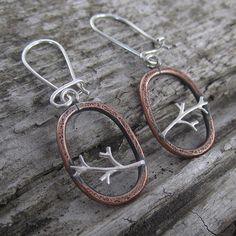 I love the contrast between the smooth, bright silver and the roughened, darkened copper...Oval Tree Branch Recycled Copper and Sterling Silver Earrings by Beth Millner Jewelry--Find them at www.bethmillner.com