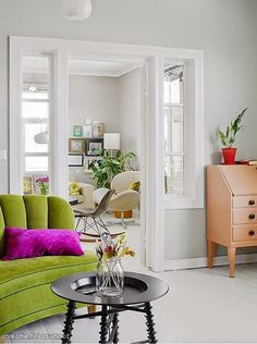 White with colorful furniture