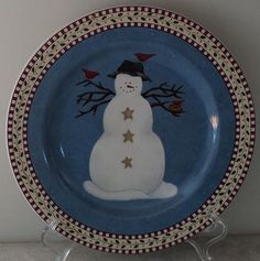 Sakura Debbie Mumm Snowman These are a set of my Christmas dinner ware. These are the salad plates. There are 4 differant patterns per set.