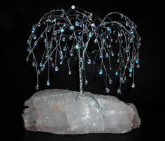 """beaded weeping willow, silfer floral wire and iridescent teardrop beads on """"Utah Ice"""" from an aquarium store"""