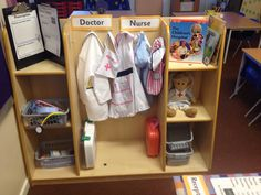 Medical role play area. Nurse and doctor outfit, equipment, prescriptions, books and writing hooks- symptoms of the patient. Dramatic Play Area, Dramatic Play Centers, Doctor Games For Kids, Kids Playing Doctor, Doctor Role Play, People Who Help Us, Role Play Areas, Creative Play, Preschool Themes