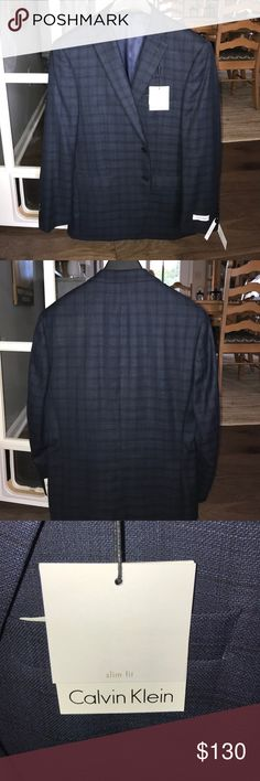 New w Tags Men's Calvin Klein Blazer 100% Wool Slim Fit 40s Men's Calvin Klein Blazer brand new with tags from store. 100% wool. Two vents at back (one shown). Navy blue with subtle darker lines forming blue plaid/checkers. Parents paid 300+$ while in New York to find out doesn't fit me. Fast shipping! Feel free to make an offer! SERIOUS INQUIRIES ONLY, TOO MANG PEOPLE HAVE BEEN TRYING TO SCAM ME... Calvin Klein Suits & Blazers Sport Coats & Blazers