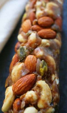 No-cook, vegan snack made with dates, coconut oil, shredded coconut, cashews, pistachios and almonds. Something sweet in the middle of the day? Yes please. Make it guilt-free. Start with a smooth, silky, EASY date caramel. (Taste this…..YUMMMM, right?) Stir in nuts. Shape. Chill. Slice. Store. If you are using the firmer Noor date variety then, …
