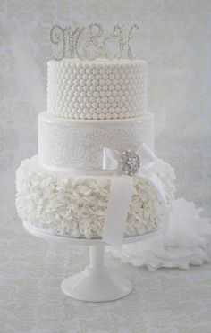 Stunning!~ White in White with lace, petals ruffles and a little sparkle. ~ all edible