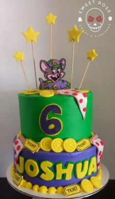 Chuck e cheese themed birthday cake. All buttercream with fondant detail