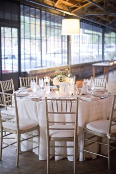 Love this monochromatic approach in a loft like space perfect for a Metropolitan Bride!