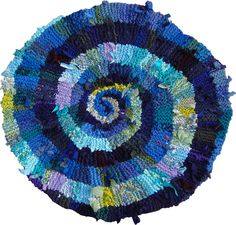 Blue green spiral rug.  Sold.  See more at www.rugsfromrags.com/sold