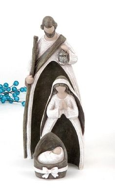 Nesting Silent Night Nativity: The words of the classic Christmas hymn artfully engraved on the figurines of this nesting nativity.