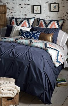 loving this pin tucked navy blue bedding
