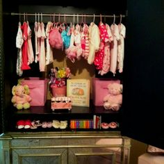 beautiful baby armoire- like the idea of adding a shelf for her shoes