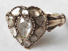 This stunning Antique Georgian Diamond cluster ring features approx of Rose cut Diamonds set in Silver on a Yellow Gold fancy band, dating to circa. Gems Jewelry, Heart Jewelry, Diamond Jewelry, Diamond Pendant, Diamond Rings, Jewlery, Jewelry Watches, Fine Jewelry, Heart Engagement Rings