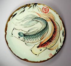 High-fire stoneware koi platter with embossed lucky chop and success seal. By Tracie Griffith Tso of Reston, Va.