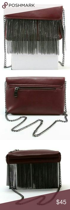 Steve Madden Blite Chain Crossbody Steve Madden Blite Crossbody Create the perfect rocker chic look with the Steve Madden? Blite Chain Crossbody bag Condition NWT   Made of polyurethane with chained fringe detail. Magnetic snap closure. Chained crossbody strap. Exterior back zip pocket. Lining made of polyester. Interior back-wall zip pocket. Two interior multifunctional slip pockets. Imported. Measurements: Bottom Width: 8 in Depth: 1 1?2 in Height: 6 in Strap Length: 48 in Strap Drop: 23…
