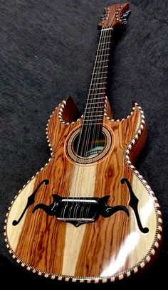 [ƒrettedchordophone 2014] A rather lovely Bajo Quinto - I dont know who made it but it looks like a good job --- https://www.pinterest.com/lardyfatboy/