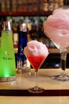 Cotton Candy Martini    You will need:  Raspberry flavored Vodka  Chambord (Raspberry liqueur)  Grenadine -- a splash  Champagne -- a splash  Pink cotton candy  Crushed ice  Sugar  Chill martini glasses, sugar the rim & add generous chunk of cotton candy in each glass.  Place the ice in a cocktail shaker, add the vodka and Chambord.and a genero