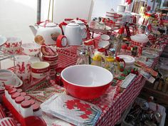 I'd love to find a flea market booth like this one! red handle kitchen utensils enamel ware and other red stuff.