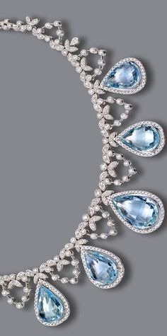 AQUAMARINE AND DIAMOND NECKLACE The necklace of delicate garland design set with numerous small round diamonds, supporting 5 pear-shaped aquamarines weighing approximately 35.50 carats, within borders of small round diamonds, the total diamond weight approximately 7.25 carat, mounted in 18 karat white gold, length 15½ inches.