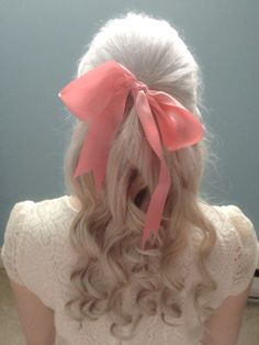 Beautiful curls with pink ribbon.