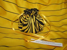 "Jewelry Pouch.  A Wow Pouch!  Compartments inside this bright pouch separate and protect your jewelry while traveling.  Over 150 other designs also available.  These make wonderful stocking stuffers for Christmas.  ""Zebra Zing"" Jewelry Pouch. $8.99, via Etsy."