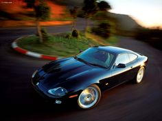 Images of Jaguar XKR Coupe - Free pictures of Jaguar XKR Coupe for your desktop. HD wallpaper for backgrounds Jaguar XKR Coupe car tuning Jaguar XKR Coupe and concept car Jaguar XKR Coupe wallpapers. Jaguar Cars, Jaguar Xj, Car Tuning, Concept Cars, Jeep, Classic Cars, Sporty, Bike, Vehicles