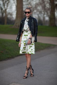 Street Style  Edgy and pretty come together in one chic look.  Read more: Dior Belted Dress and Coat - London Fashion Week Street Style - Harper's BAZAAR   Credit: Diego Zuko